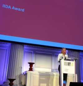 Abigail French, Industry IIDA, from Herman Miller presenting the Leadership of Excellence Award commemorative object, the special edition Eames stool