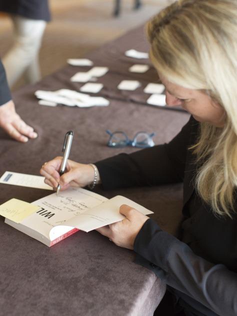 (Photo by Sam Breach) Award-winning writer Cheryl Strayed signing autographs at Leaders Breakfast San Francisco.